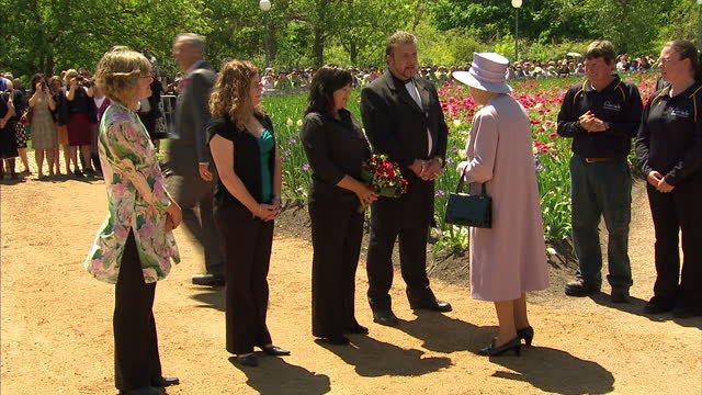 exterior shots the queen being given a tour of the canberra flower festival floriade queen in australia canberra on october 20 2011 in canberra... - canberra stock videos & royalty-free footage