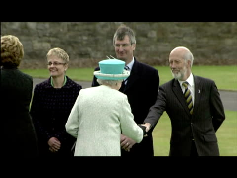 exterior shots the queen meets first minister of northern ireland peter robinson & other members of the stormont cabinet. the queen greets peter... - other stock videos & royalty-free footage