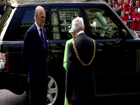 exterior shots the queen prince philip get out of car are greeted by dignitaries including the mayor queen prince philip arrive in cork on may 20... - the queen stock videos and b-roll footage