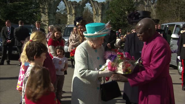 Exterior shots the Queen Princess Beatrice walk from Museum over to greet well wishers where they accept bouquets of flowers Exterior shots the Queen...