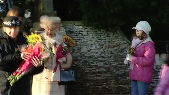 Exterior shots the Queen takes flowers from well wishers Exterior shots Prince Charles Camiila Duchess of Cornwall walk past Exterior shot Prince...