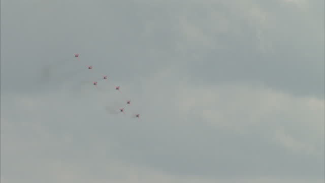 stockvideo's en b-roll-footage met exterior shots the red arrows flying in formation over chatsworth country fair in derbyshire red arrows return to sky after pilots death on september... - derbyshire