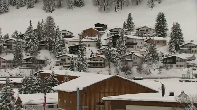 exterior shots the town of davos in the swiss alps covered in snow on january 20 2016 in davos switzerland - ダボス点の映像素材/bロール