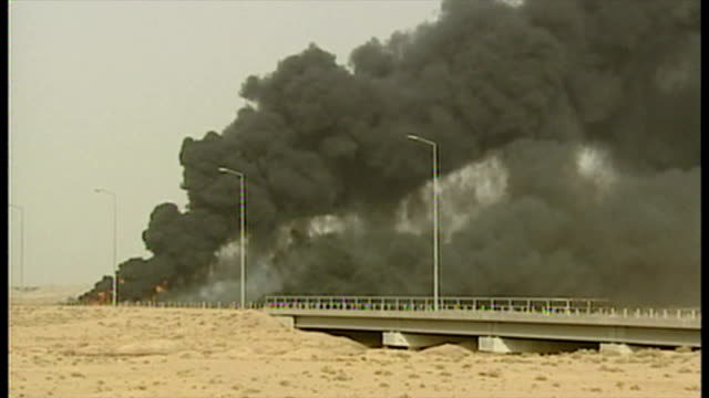 exterior shots thick black smoke rises into the air as oil fires burn at the start of the 2003 invasion of iraq on march 27 2003 in basra iraq - bassora video stock e b–roll