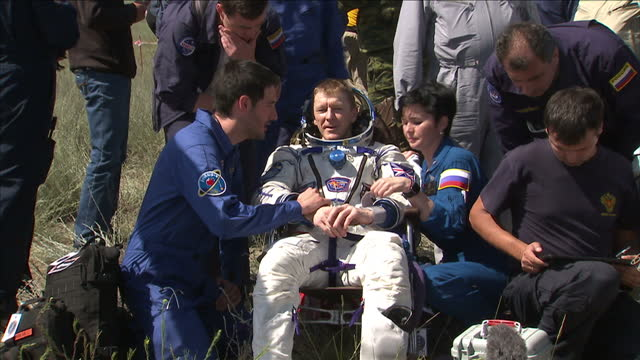 exterior shots tim peake, british astronaut is checked by medical team after being brought out of the soyuz tma-19m capsule that returned him to... - astronaut stock videos & royalty-free footage