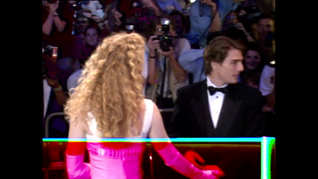 exterior shots tom cruise and nicole kidman pose for press outside far and away film premiere. - ニコール・キッドマン点の映像素材/bロール
