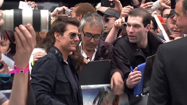 exterior shots tom cruise poses for the press on the red carpet at the rock of ages premiere before walk over to meet waiting fans sign autographs... - tom cruise stock videos & royalty-free footage