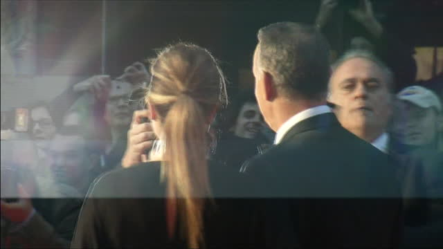 Exterior shots Tom Hanks actor and Rita Wilson wife walking on the red carpet for the premiere of Captain Phillips Includes shots of Tom Hanks...