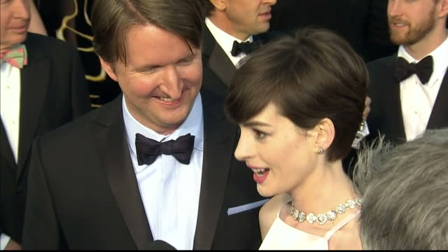 Exterior shots Tom Hooper Anne Hathaway chat to reporters on the red carpet Tom Hooper Anne Hathaway on the Red Carpet at Dolby Theatre on February...