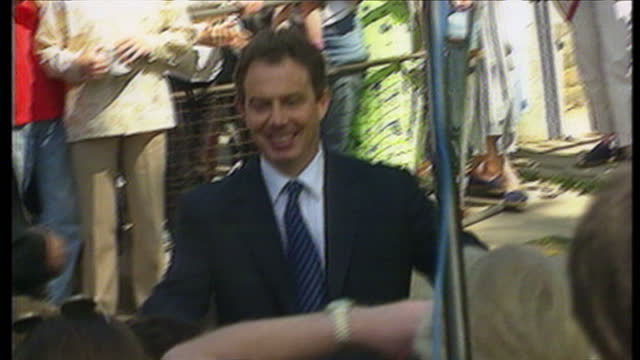 exterior shots tony blair & cherie blair leave their family home in richmond crescent to cheers from the crowds after election victory. on may 2nd,... - コベントリー点の映像素材/bロール