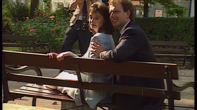 exterior shots tony blair cherie blair sitting together on park bench for photocall on august 5th 1994 in unspecified united kingdom - anno 1994 video stock e b–roll
