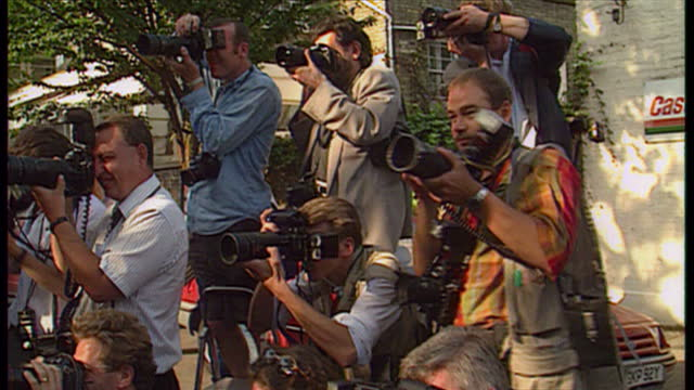 exterior shots tony blair & cherie blair walk from front door of their house & pose holding hands for photocall. on august 5th, 1994 in unspecified,... - コベントリー点の映像素材/bロール