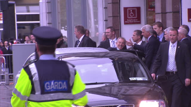 Exterior shots Tony Blair departs book store climbs into car before being driven away past noisy protestors Tony Blair holds his first book signing...