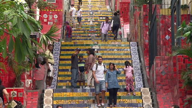Exterior shots tourists having pictures taken on the Escadaria Selaron tiled steps Escadaria Selaron In Lapa on June 24 2013 in Rio de Janeiro Brazil