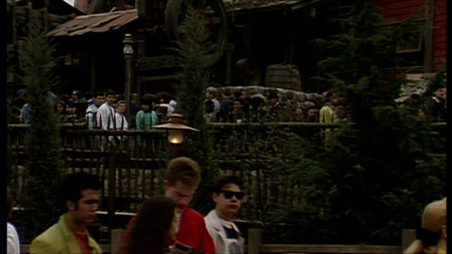 exterior shots tourists queuing up to go on rides at euro disney resort on opening weekend on april 11 1992 in paris france - disney stock videos and b-roll footage