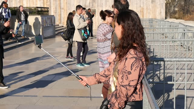 exterior shots tourists taking pictures photographs and selfies in front of landmarks on 16th february 2017 paris france - eiffel tower stock videos & royalty-free footage