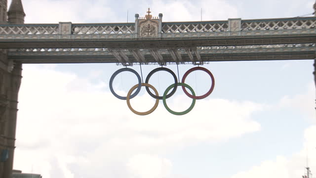exterior shots tower bridge with the olympic rings logo hanging from the central span sky news 2012 olympics coverage on july 12 2012 in london... - 2012 stock videos and b-roll footage