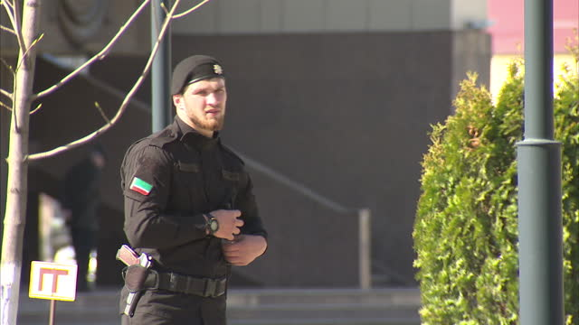 exterior shots traffic street scenes in grozny exterior shots chechnya's security officers in streets on april 16 2015 in grozny russia - grosny stock-videos und b-roll-filmmaterial