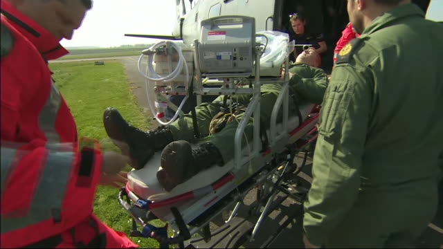 exterior shots training exercise unloading patients off of military aircraft's for treatment 10 april 2020 in hampshire england - emt unloading stock videos & royalty-free footage