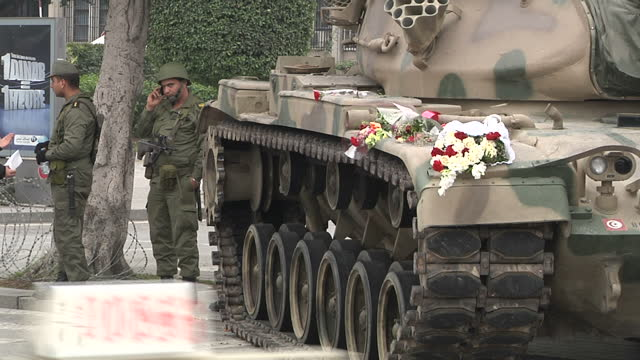 Exterior shots Tunis street scenes with army soldiers security forces and tank with flowers laid on it on January 25 2011 in Tunis Tunisia