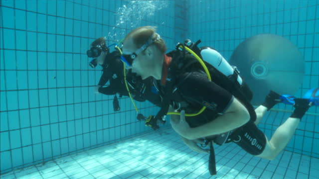 exterior shots underwater prince william scuba diving in swimming pool. on july 09, 2014 in london, england. - aqualung diving equipment video stock e b–roll