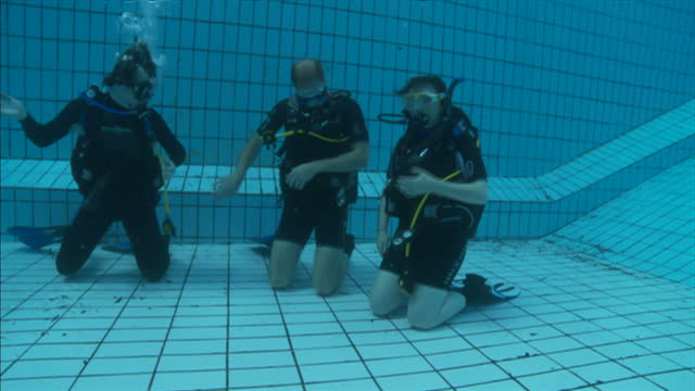 exterior shots underwater prince william scuba diving & resting on his knees at bottom of the pool. on july 09, 2014 in london, england. - aqualung diving equipment video stock e b–roll