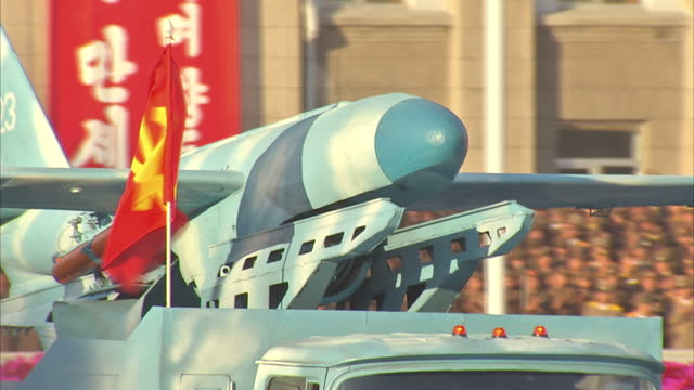 exterior shots unidentified north korean drones are displayed on back of military vehicles during workers party 70th anniversary military parade on... - parade stock videos & royalty-free footage