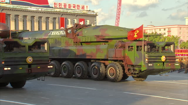 exterior shots unidentified north korean missiles are displayed on back of military vehicles during workers party 70th anniversary military parade on... - missile armi video stock e b–roll