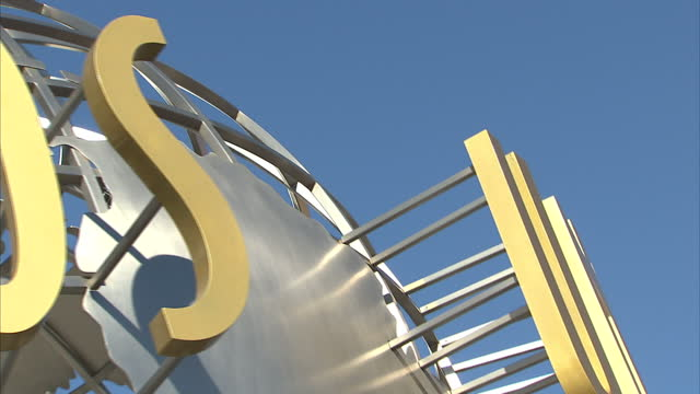 exterior shots universal studios globe spinning against clear blue sky on february 14 2012 in los angeles california - nbcuniversal video stock e b–roll