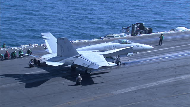 exterior shots us navy f/a18e super hornet jet taking off from flight deck of us navy uss dwight d eisenhower aircraft carrier on october 11 2012 in... - united states navy stock-videos und b-roll-filmmaterial