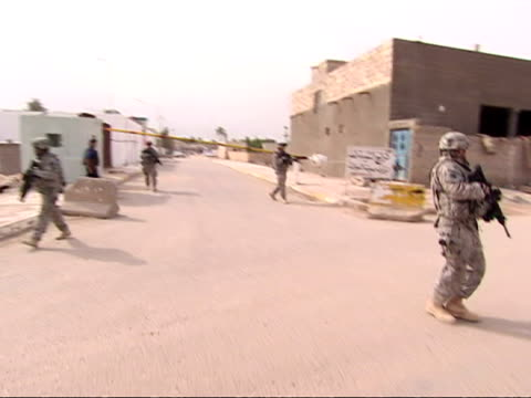 exterior shots US solders patrolling through the streets of Basra US Soldiers on Foot Patrol in Basra on April 01 2009 in Basra Iraq