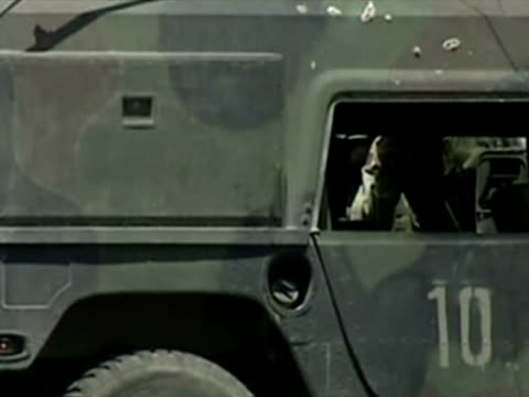 stockvideo's en b-roll-footage met exterior shots us soldiers and iraqi police at scene of ied bomb hitting us humvee vehicle damaged vehicle us humvee hit by ied in baghdad on july 28... - humvee