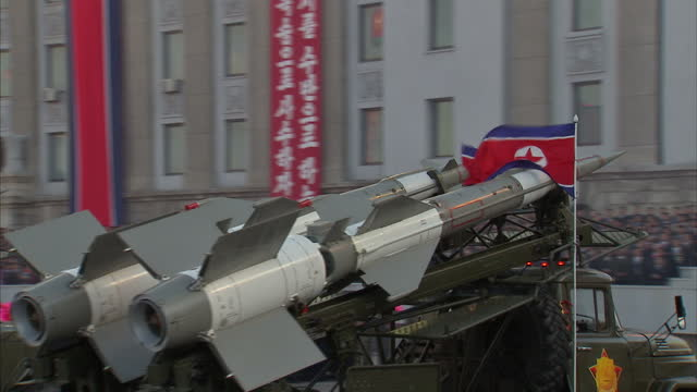 exterior shots various north korean missiles are displayed on back of military vehicles during workers party 70th anniversary military parade on... - military parade stock videos & royalty-free footage