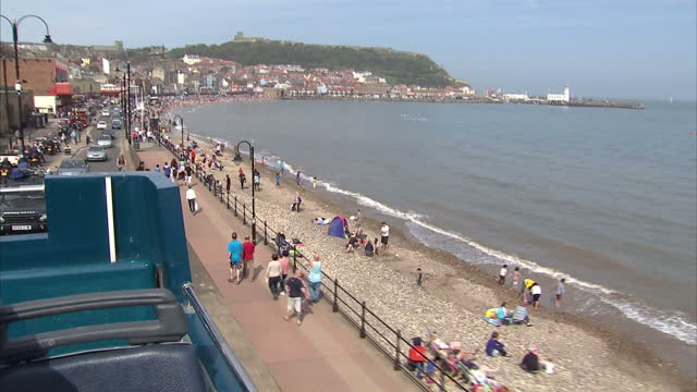 Exterior shots various shots of Scarborough from open top tour bus UK Enjoys Warmest May Bank Holiday in Years on May 06 2013 in scarborough England