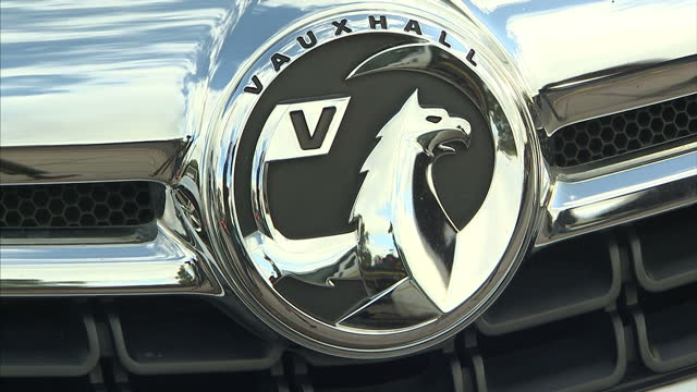 exterior shots vauxhall car badges on cars outside vauxhall dealership car showroom on october 22 2015 in birmingham england - showroom stock videos & royalty-free footage