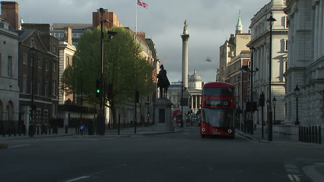 exterior shots vehicles driving along whitehall with trafalgar square and nelson's column in the background on may 05 2015 in london england - cityscape stock videos & royalty-free footage