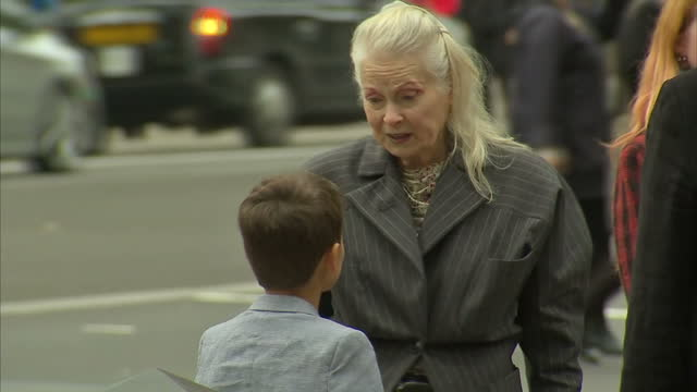 exterior shots Vivienne Westwood Designer with 9 year old Fracking Boy Joe Corre at gates to 10 Downing Steet