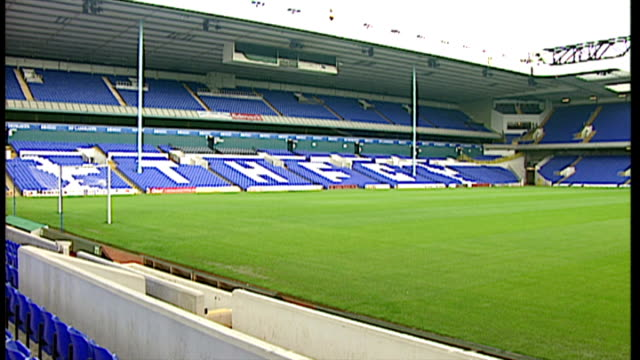 exterior shots white hart lane football stadium home to tottenham hotspurs fc empty stands inside the stadium and cockerel mascot on top of stand on... - tottenham hotspur f.c stock videos & royalty-free footage