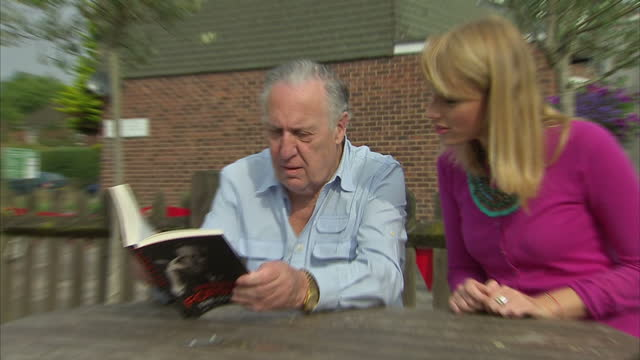exterior shots writer frederick forsyth talking to woman in pub garden on august 30 2015 in high wycombe england - frederick forsyth stock videos & royalty-free footage