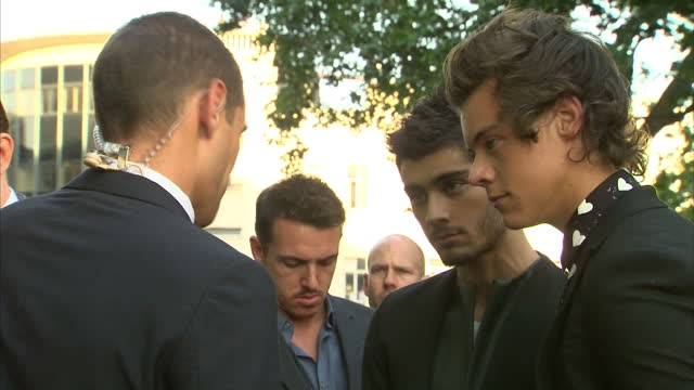 Exterior shots Zayn Malik Harry Styles talking to a reporter Zayn Malik And Harry Styles Speaking To Reporter on August 20 2013 in London England
