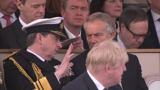 exterior shottony blair sat chatting to man wearing decorated clothing at war memorial service which honoured the service and duty of both the uk... - war memorial stock videos & royalty-free footage