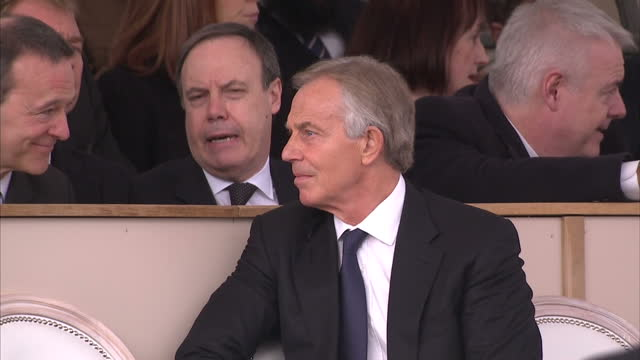 exterior shottony blair sat chatting to people seated behind him at war memorial service which honoured the service and duty of both the uk armed... - war memorial stock videos & royalty-free footage
