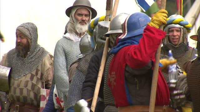 exterior showing battle re enactment fans in historically accurate dress including chain mail helmets and shields on june 29 2014 in bannockburn... - スコットランド スターリング点の映像素材/bロール