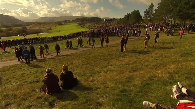 exterior showing golf fans at gleneagles for ryder cup at gleneagles on september 29, 2014 in auchterarder, scotland. - pgaイベント点の映像素材/bロール