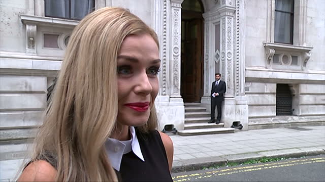 vidéos et rushes de exterior showing opera singer katherine jenkins arriving and posing for pictures before briefly speaking to press about why she is at the event - emma freud
