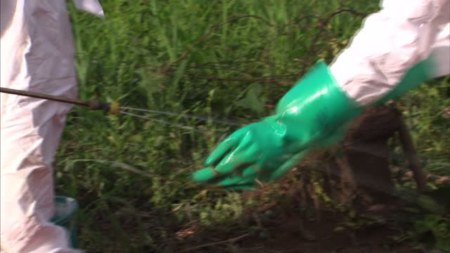 exterior showing part 3 of 3 reporter chatting with local residents of township where ebola cases have been found health workers in full white... - dead person stock videos & royalty-free footage