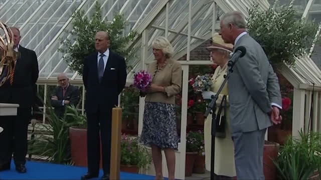 stockvideo's en b-roll-footage met exterior showing prince charles and queen elizabeth unveiling a globe style monument in the gardens of dumfries house prince philip and camilla look... - dumfries en galloway