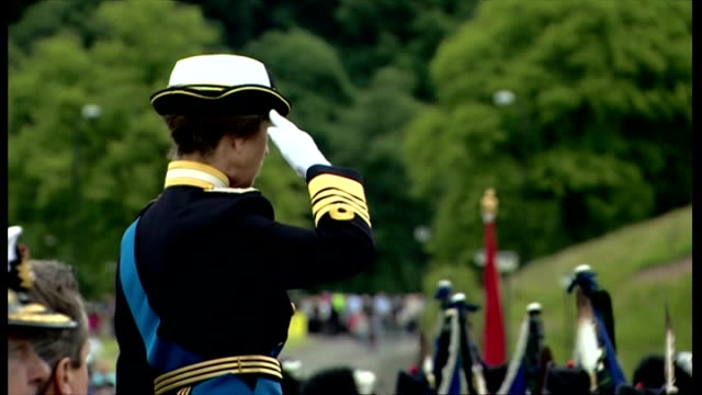 exterior showing princess anne on an elevated podium saluting as various armed service personnel march past in formation, brass band leads the way - stirling stock videos & royalty-free footage
