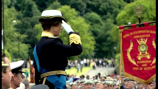 exterior showing princess anne on elevated podium saluting the passing brigades of service personnel, young and old, cadets and veterans all dressed... - military uniform stock videos & royalty-free footage