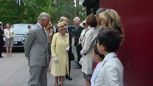 exterior showing queen elizabeth prince philip prince charles and camilla meeting and greeting line of officials shaking hands making small... - verwaltungsbehörde dumfries and galloway stock-videos und b-roll-filmmaterial